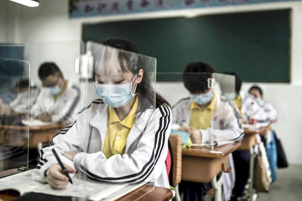 WUHAN, CHINA - MAY 06: (CHINA OUT) Senior students study in a classroom with transparent boards placed on each desk to separate each other as a precautionary measure against the spead of COVID-19 at Wuhan No. 23 Middle School on May 6, 2020 in Wuhan, Hubei Province, China .About 57,800 students in their final year from 121 high and vocational schools returned to campus on Wednesday in Wuhan, The city previously hard hit by the COVID-19 outbreak.(Photo by Getty Images)