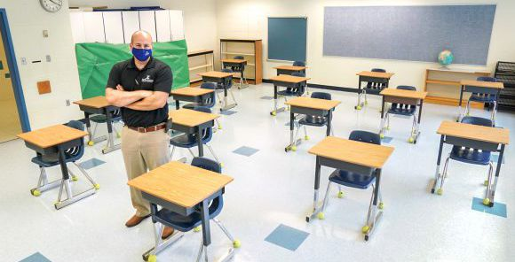 Fairfax County Public Schools assistant director of facilities management Todd Jones stands in a classroom where desks have been spaced to prevent the spread of the coronavirus disease (COVID-19) at Mantua Elementary School in Fairfax, Virginia, U.S., July 17, 2020.  REUTERS/Kevin Lamarque